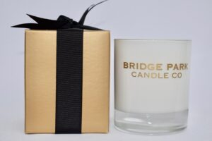 Bridge Park Candle Company Black Pomegranate candle and gold box tied with a black ribbon