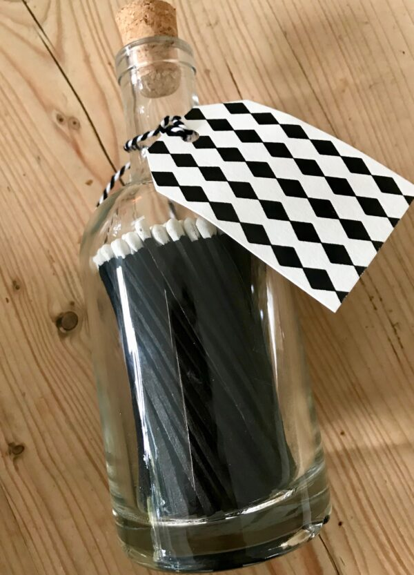 Black matches in glass jar